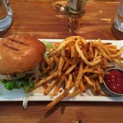 Chicken thigh sandwich with fries at Barque BBQ.